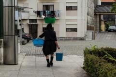 Lady balances washing on her head